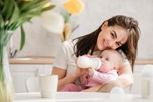 Woman Feeding Newborn With For...