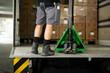 canvas print picture - Mann schiebt Umzugskarton in Lastwagen mit Gabelstapler