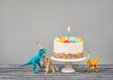 Toy Dinosaurs Eat Cake at a Birthday Party