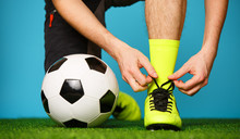 Soccer Player Tying His Shoes