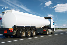 The White Oil Truck Is Going Up The Road. Cargo Transportation Concept.