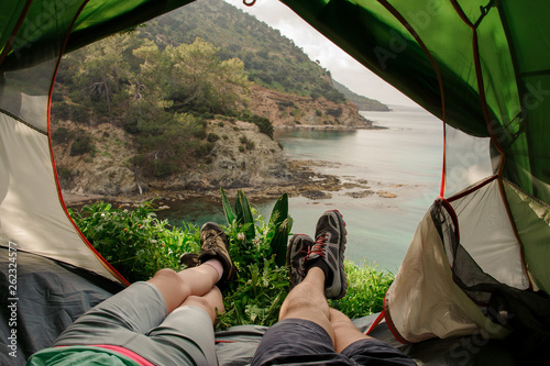 Fotobehang Ontspanning View of mountains and seashore from a tent