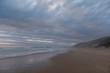 The sandy beach at Brenton on Sea, photographed at dusk. Knysna, South Africa.