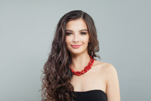 Stylish Brunette Model Woman With Long Hair And Red Coral Necklace, Portrait