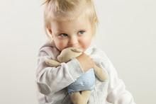 An Adorable Baby Girl Hugging ...