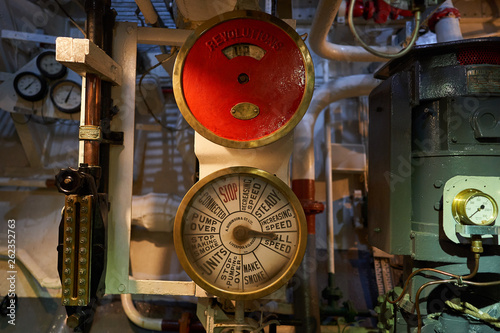 Engine order telegraph to comunicate movement of ship from captain bridge in boiler room of steam powered war ship or batte ship from world war two served in Royal british navy in atlantic ocean Fototapeta