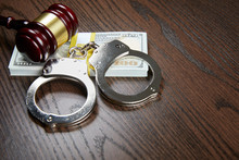 MONEY, GAVEL AND HANDCUFFS ON ...