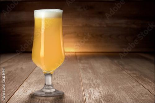 Fotografia, Obraz Hazy NEIPA New England IPA pale ale craft beer, on wood surface, rich frothy foa