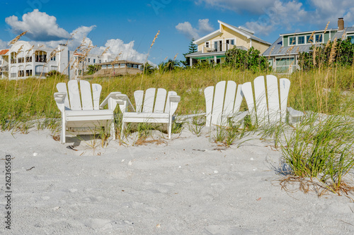 White Adirondack beach chairs on the white sand  on Pass-A-Grille's beach, St Wallpaper Mural