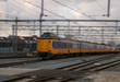 yellow train or intercity driving very quick with motion blur, scenic wallpaper