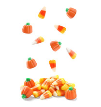 Set Of Delicious Candies Falling Into Pile On White Background