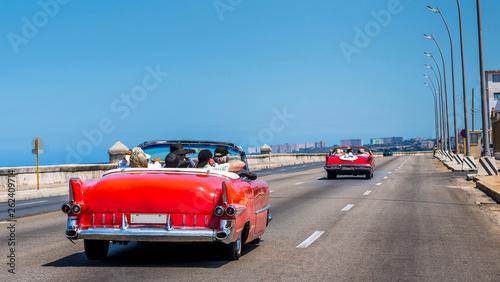 Photo Stands Havana Havana Cuba. Old American cars runing along the malecon in la Habana.