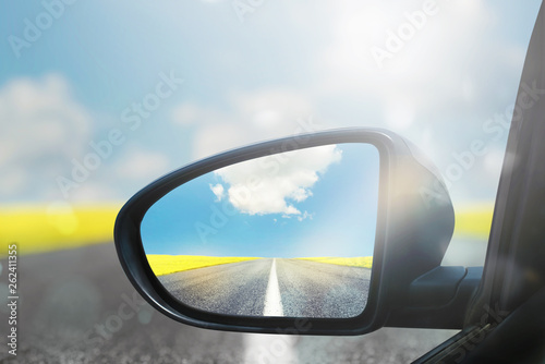 Wing mirror of a car with beautiful panorama reflected