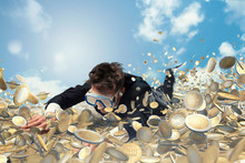 Businessman Swims In A Pool Of Money