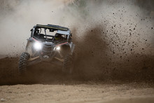 Offroad Vehicle In The Action On Mud