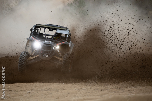 Offroad vehicle in the action on mud Fototapeta