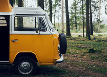 Old Volkswagen Bus In The Forest.