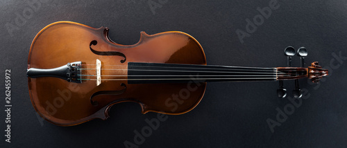 Canvas top view of classical cello on black background