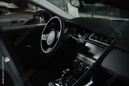 Fototapeta black steering wheel near gear shift in luxury car obraz na płótnie