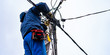 the electrician vysotnik makes installation of power grids