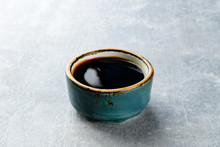Soy Sauce In A Plate On A Gray...