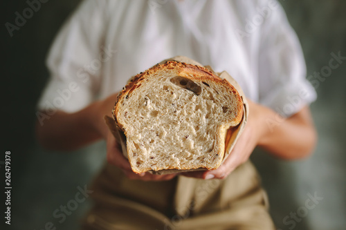 Female baker with fresh bread Canvas Print
