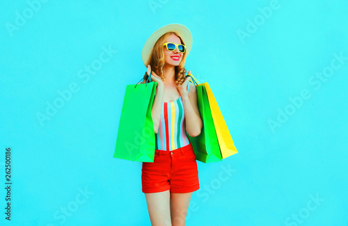 2cf5e656 Portrait happy young smiling woman with shopping bags in colorful t-shirt,  summer round