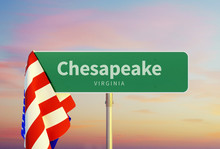 Chesapeake - Virginia. Road Or Town Sign. Flag Of The United States. Sunset Oder Sunrise Sky