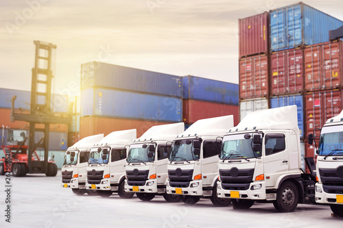 New truck fleet with container depot as for shipping and logistics transportation industry Wallpaper Mural