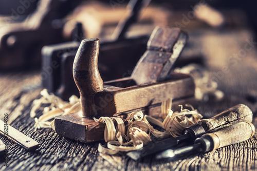 Valokuva  Old planer and other vintage carpenter tools in a carpentry workshop
