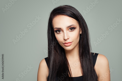 Valokuva  Portrait of brunette woman with straight hair