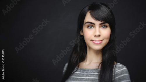 Fototapeta  Young female student smiling