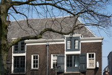 Old House With Wooden Windows, Blue Shutters, In Historical Town Dordrecht, The Netherlands