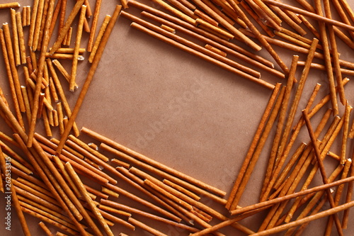 Crispy bread straw on brown paper background Canvas