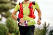 Leinwanddruck Bild - male athlete run mountain race with hydratation trail vest for running