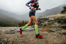 Woman Runner Run Mountain Race With Trail Vest For Running
