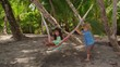 3 young kids playing with hammock Costa Rica