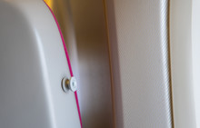 Aeroplane Seat With Coat Hook At The Side. Close Up Image.