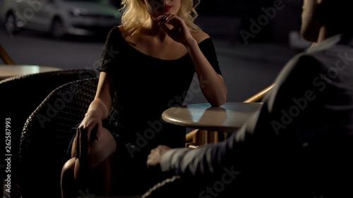 Carta da parati  Evening date, beautiful female sitting in cafe and seducing man, passion