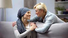 Smiling Woman With Cancer Hugging Mother, Hope And Togetherness, Remission