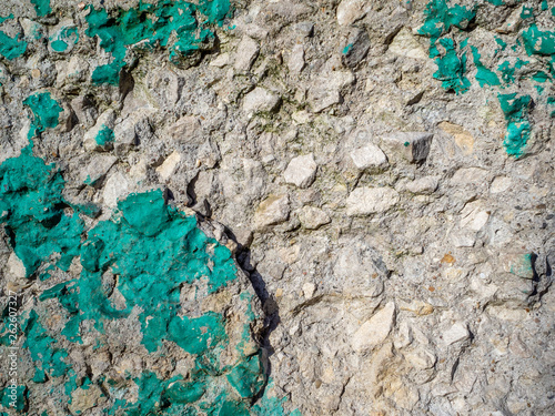 Fotografiet  The surface of the old concrete wall, gray, dirty, scratched, remnants of green
