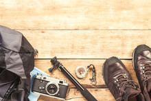 Boots, Backpack, Compass And Other Camping Gear On A Wooden Background. The Concept Of Hiking In The Mountains Or The Forest, Tourism, Tent Rest, Camp. Flat Lay, Top View.