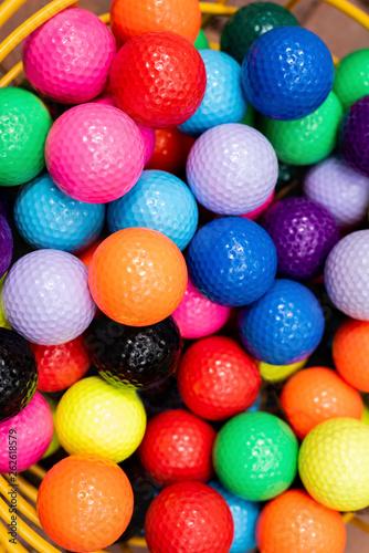Valokuva  Colorful golf balls in wire bucket for putt-putt or driving range