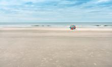 One Beach Umbrella For Tourists On A Wide, Sandy Beach