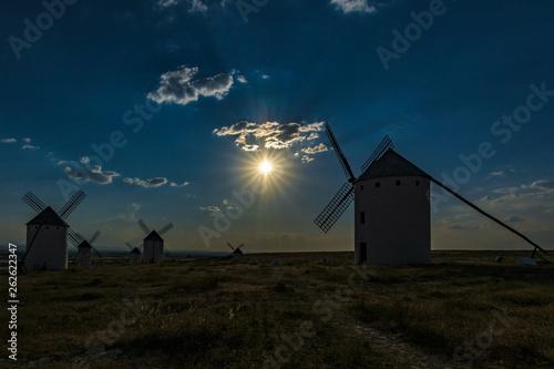 Foto  Few windmills in Campo de Criptana at sunset , Ciudad Real