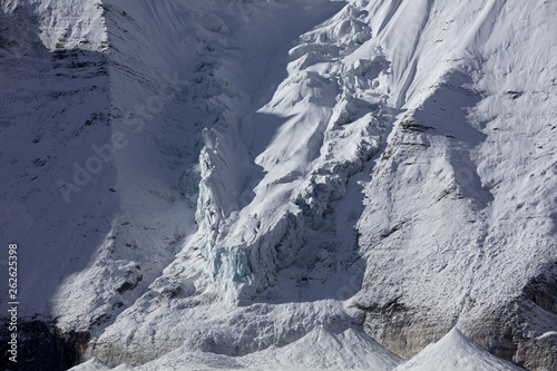 Valokuva  Snow Mountain, Massive Glacier, Wall of Ice, Mountain Cliff Face covered in ice,