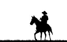 Silhouette Cowboy Riding Horse...
