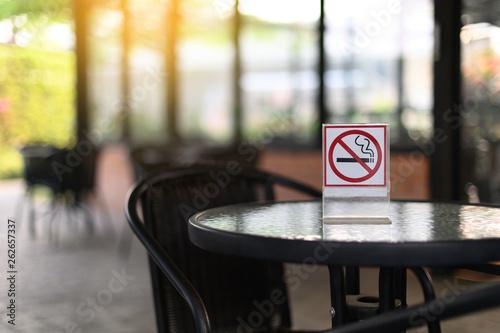 Photo No smoking sign with place Don't smoking sign park