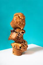 Big Muffins Balancing On Teal Background