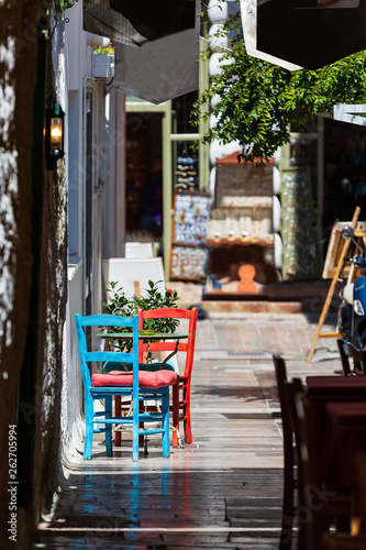Deurstickers Illustratie Parijs Nafplio, Greece old town view with red and blue colorful table and chairs in small street cafe in Nafplion, Peloponnese